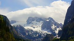 Hoher Dachstein mountains with white cloud and snow Stock Footage