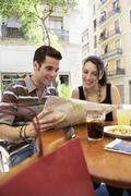 Couple Reading Map At Sidewalk Cafe Stock Photos