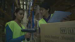 Engineers using digital tablet and barcode reader in factory - stock footage