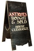 Foldable antiques and house clearance signboard isolated on white Stock Photos