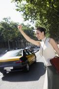 Businesswoman Hailing A Cab Stock Photos