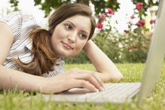 Stock Photo of Businesswoman Using Laptop At Park