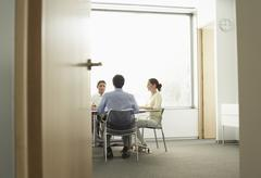 Stock Photo of Businesspeople Having A Meeting In Boardroom