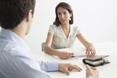 Stock Photo of Businesswoman Discussing With Male Colleague