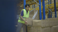 Woman using digital tablet in logistics warehouse Stock Footage