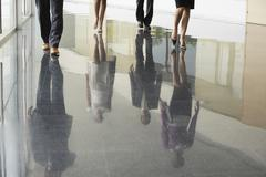 Business People Walking On Marble Flooring - stock photo