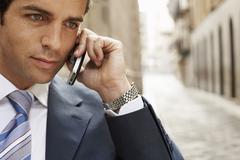 Businessman Using Mobilephone In Street - stock photo