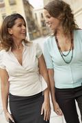 Businesswomen Walking Through Town - stock photo