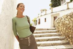 Woman On Steps Leaning On Wall In Granada Stock Photos