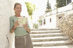 Woman On Steps Reading Map In Granada - stock photo