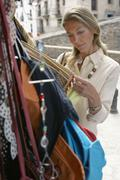 Woman Shopping For Bags At Market Stall Stock Photos