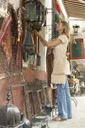 Woman Shopping At Souvenir Stall - stock photo