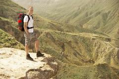Stock Photo of Hiker Standing On Top Of Mountain