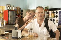 Stock Photo of Portrait Of Happy Relaxed Couple In Bar
