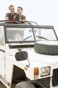 Happy Couple In Four-Wheel-Drive Car Outdoors - stock photo