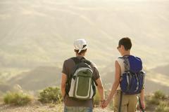 Hiking Couple On Top Of Mountain - stock photo