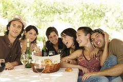 Friends With Drinks And Bread Basket At Table Enjoying Party Stock Photos