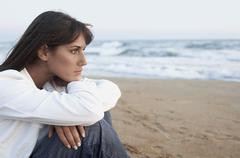 Stock Photo of Thoughtful Woman Looking Away At Beach