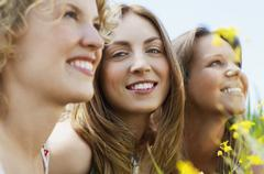 Woman Smiling While Friends Looking Away - stock photo
