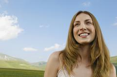 Stock Photo of Girl Looking Away While Smiling At Park