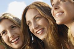 Female Friends Looking Away While Smiling - stock photo