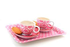 Cheerful pink crockery with coffee Stock Photos