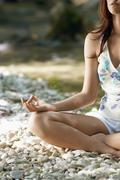 Cropped Image Of Woman Meditating In Lotus Position Stock Photos