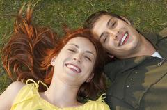 Stock Photo of Closeup Of Happy Couple Lying On Grass