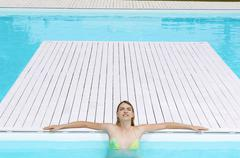 Girl With Eyes Closed Sunbathing At Poolside Stock Photos