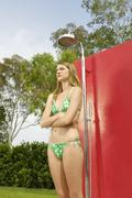 Irritated Woman In Bikini Standing Under Shower Stock Photos