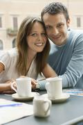 Happy Couple Sitting At Cafe In Rome - stock photo