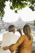 Couple Photographing Cathedral In Rome - stock photo