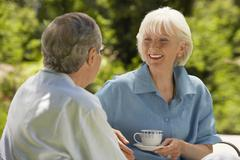 Senior Couple Conversing In Backyard - stock photo
