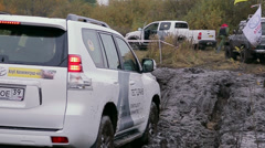 Car moves on dirty rally road - stock footage