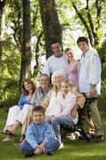 Portrait Of Happy Family In Park Stock Photos