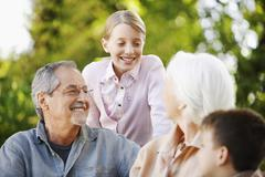 Grandparents With Grandchildren In Backyard Stock Photos