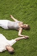 Couple Sleeping On Grass - stock photo