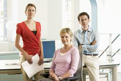 Confident Business Team In Office - stock photo