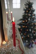 Candles Burning On Mantelpiece On Christmas Day Stock Photos