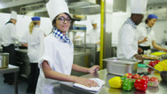 Portrait of a smiling chef in a commercial kitchen Stock Footage