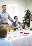 Family Enjoying Food On Christmas Stock Photos