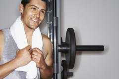 Happy Man Resting On Barbell After Workout Stock Photos