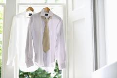 Stock Photo of Formal Shirts On Hangers At Home