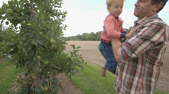 Father and son standing in farm Stock Footage
