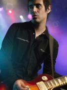 Male Rock Guitarist In Concert - stock photo