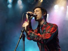 Young Man Singing Into Microphone Stock Photos