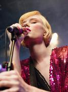 Stock Photo of Closeup Of Young Woman Singing Into Microphone