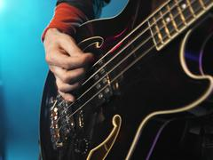 Bass Guitarist Performing - stock photo
