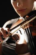 Closeup Of Woman Playing Violin Stock Photos