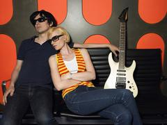 Young Couple With Guitar In Recording Studio - stock photo